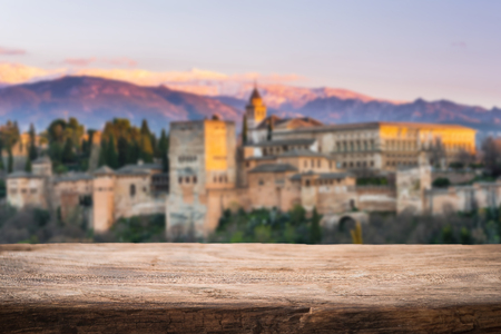 Wooden board product display with Alhambra in Spain in background Stock Photo