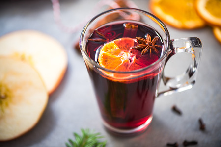 Mulled wine in Christmas and festive decoration on table. Stock Photo