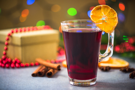 Glass cup with red mulled wine. Stock Photo