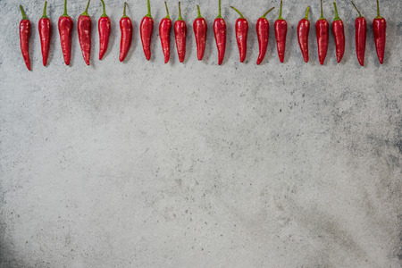 Red chili peppers in row, food background. Stock Photo