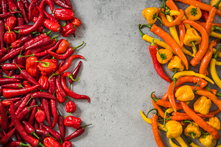 Red and yellow hot peppers background. Stock Photo