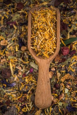 Wooden spoon on loose herbal tea. Stok Fotoğraf