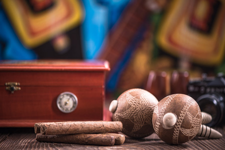 Items related to Cuba on wooden table. Stock Photo
