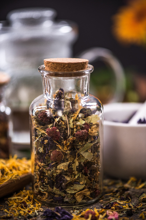 loose leaf: Tea with dried flowers and fruits in jar.