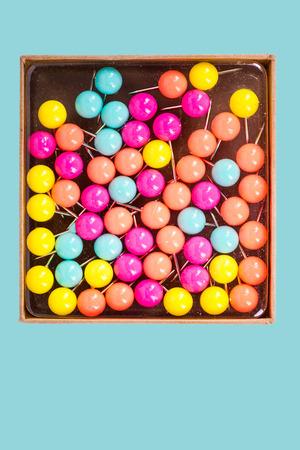 metal fastener: Box of colorful pastel push pins. Stock Photo