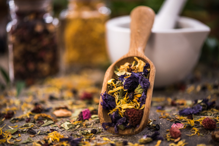 Aromatic tea with dried flowers and fruits.