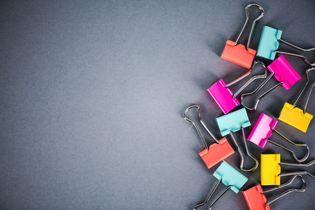 Vibrant pastel metal paperclips on grey background, office supplies Reklamní fotografie