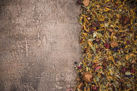 Aromatic tea border background on concrete slate.