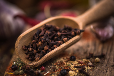 Cloves on wooden spoon,Christmas spices.