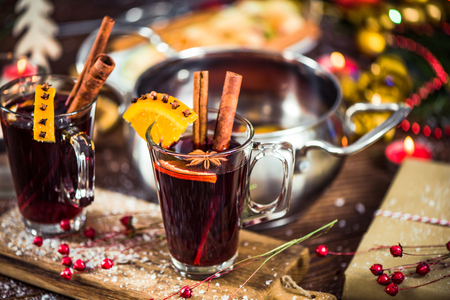 Glass with mulled wine with spices for waming on winter days. Stock Photo