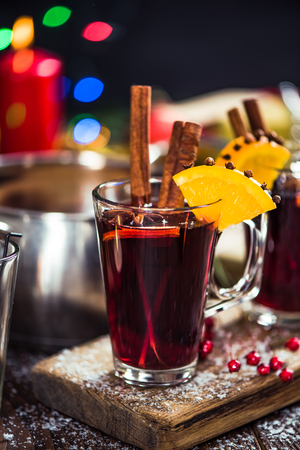 Glasses with hot warming winter mulled wine with spices. Stock Photo