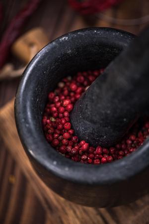 Red pepper in stone mortar or grinder. 版權商用圖片