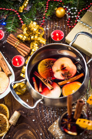 Ingredients for Christmas mulled wine in pot on festive table Stock Photo
