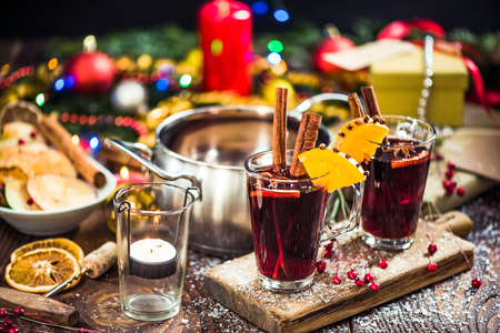 Serving mulled hot warming wine on festive Christmas table