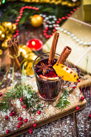 Red mulled hot wine in glass with spices. Stock Photo - 87419612