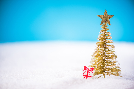 Abstract Christmas tree in snow. Stock Photo