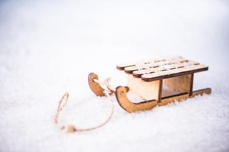 Vintage wooden snow sledge in snow.