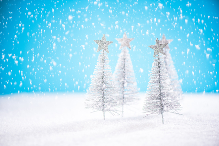 Christmas golden trees in snow.
