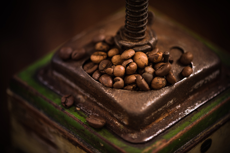 Vintage coffee grinder close up view. Coffee beans,toned image.