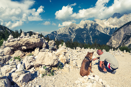 Couple travellers in Slovenia Alps mountains.