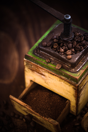 Coffee grinder with roasted coffee beans. Reklamní fotografie