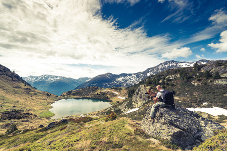 Adorra mountains, hikker and dog. Фото со стока