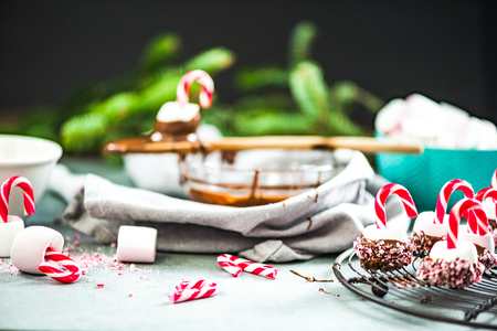Making creative Christmas sweets. Sugar cane and marshmallows in hot chocolatte. Stock Photo