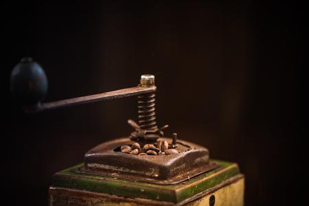 Toned image of vintage coffee grinder with roasted beans. Reklamní fotografie