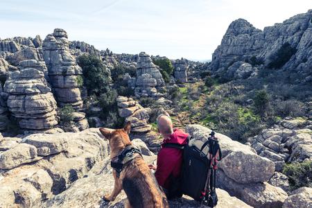 Hikker with german shepherd dog in Torcal,Spain.