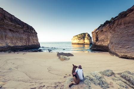 Best friends wanderlust watching sunrise at beach in Portugal.