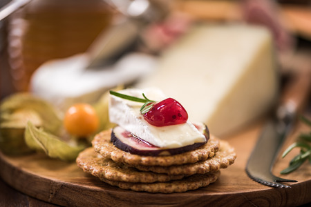 Cheese crackers with camembert,cranberry,fig and herb. Festive and Chrstmas food.