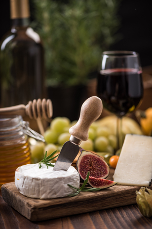 Serving camembert cheese with herbs and fig.