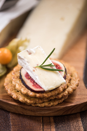 christmas cracker: Cheese crackers on board, festive food.
