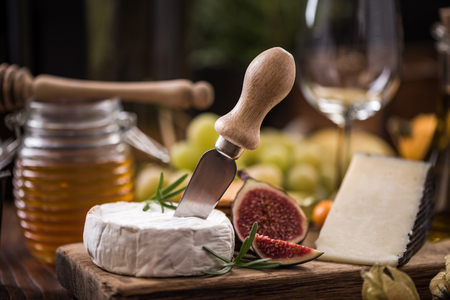 Camembert cheese on board with fig . Stock fotó - 88445942