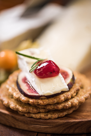 chrstmas: Cheese crackers with camembert,cranberry,fig and herb. Festive and Chrstmas food.
