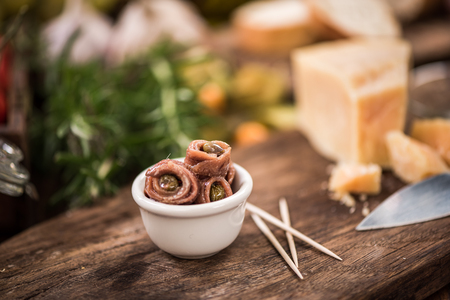 Anchovy with capers in bowl,spanish tapa bar food. Stock Photo
