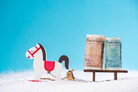 British pounds on snow sledge.