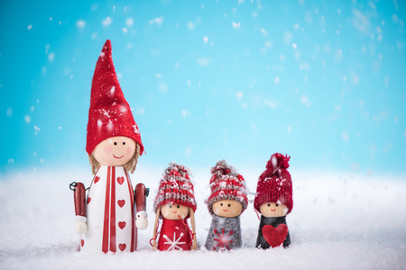 Happy family together at Christmas time in snow, wooden vintage toys Stock Photo
