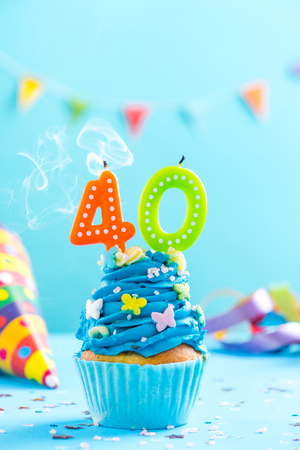 Fortieth 40th birthday cupcake with candle blow up and sprinkles. Card mockup. Stock Photo