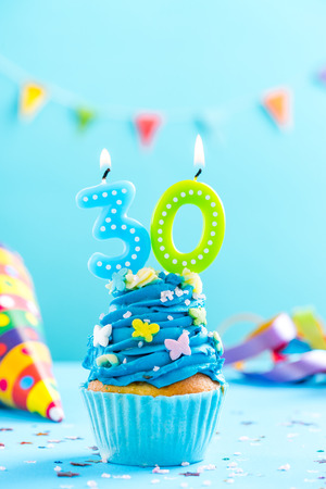 Thirtieth 30th birthday cupcake with candle and sprinkles. Card mockup.