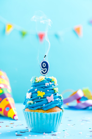 Ninth 9th birthday cupcake with candle blow up and sprinkles. Card mockup. Stock Photo