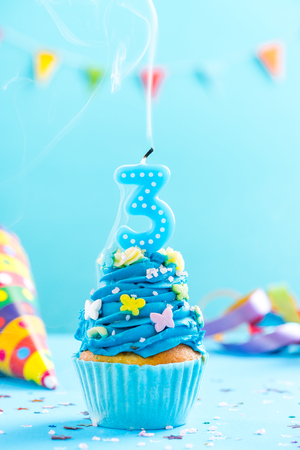 Third 3rd birthday cupcake with candle blow up and sprinkles. Card mockup.