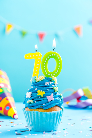 Seventieth 70th birthday cupcake with candle and sprinkles. Card mockup.