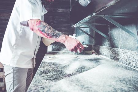 Chef working at local gasrtonomy kitchen.