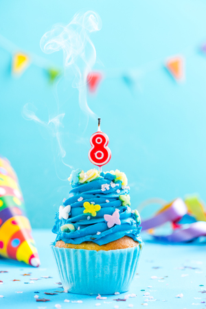 Eighth 8th birthday cupcake with candle blow up and sprinkles. Card mockup.