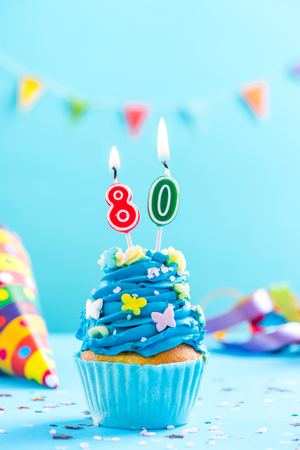 Eightieth 80th birthday cupcake with candle and sprinkles. Card mockup. Stock Photo