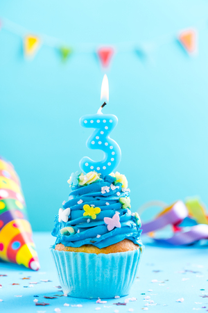 Third 3rd birthday cupcake with candle and sprinkles. Card mockup. Imagens