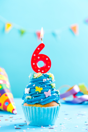 Sixth 6th birthday cupcake with candle and sprinkles. Card mockup. Stock Photo