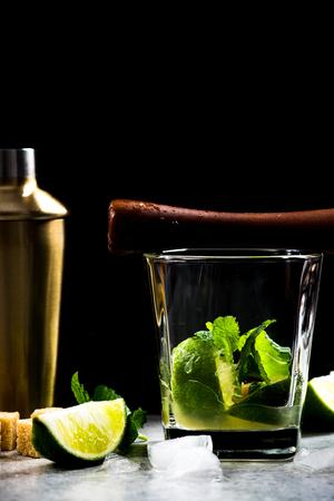 Preparation of Cuban refreshing Mojito cocktail.
