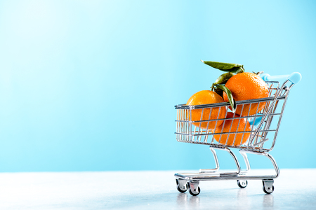 Shopping trolley cart full of oranges. Stock Photo